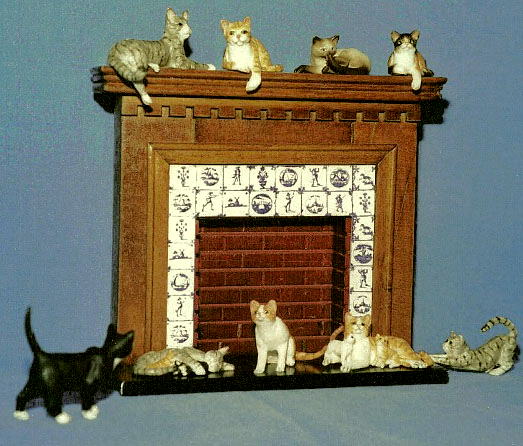 dollhouse cats with miniature fireplace