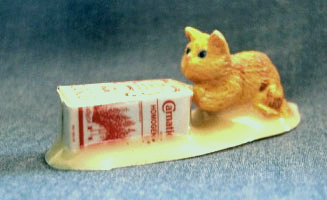 dollhouse cat with spilled milk container