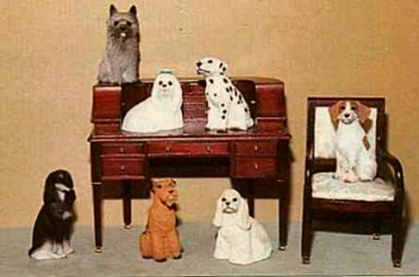 dollhouse dogs on miniature desk